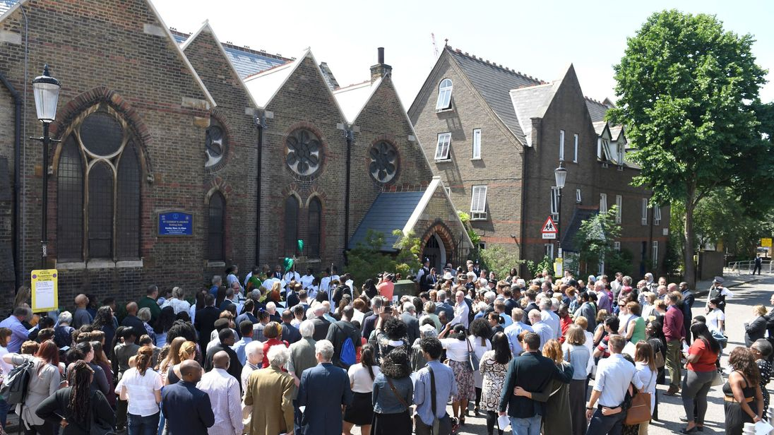 Crowds gather to attend the dedication of a new memorial garden at St Clement's Church