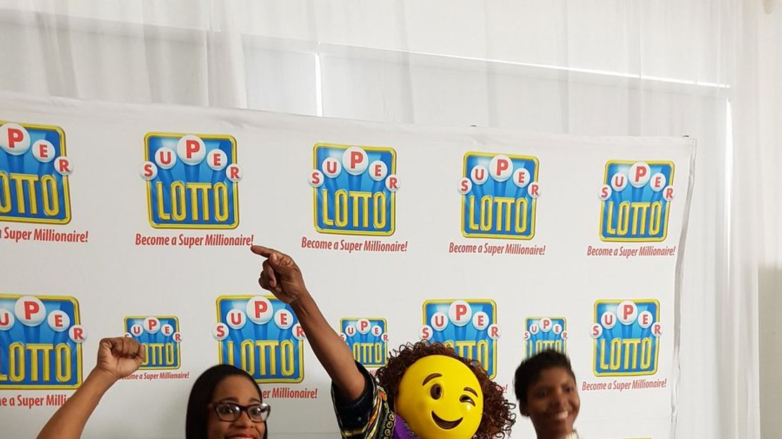Jamaican lotto winner hides face with winking emoji mask