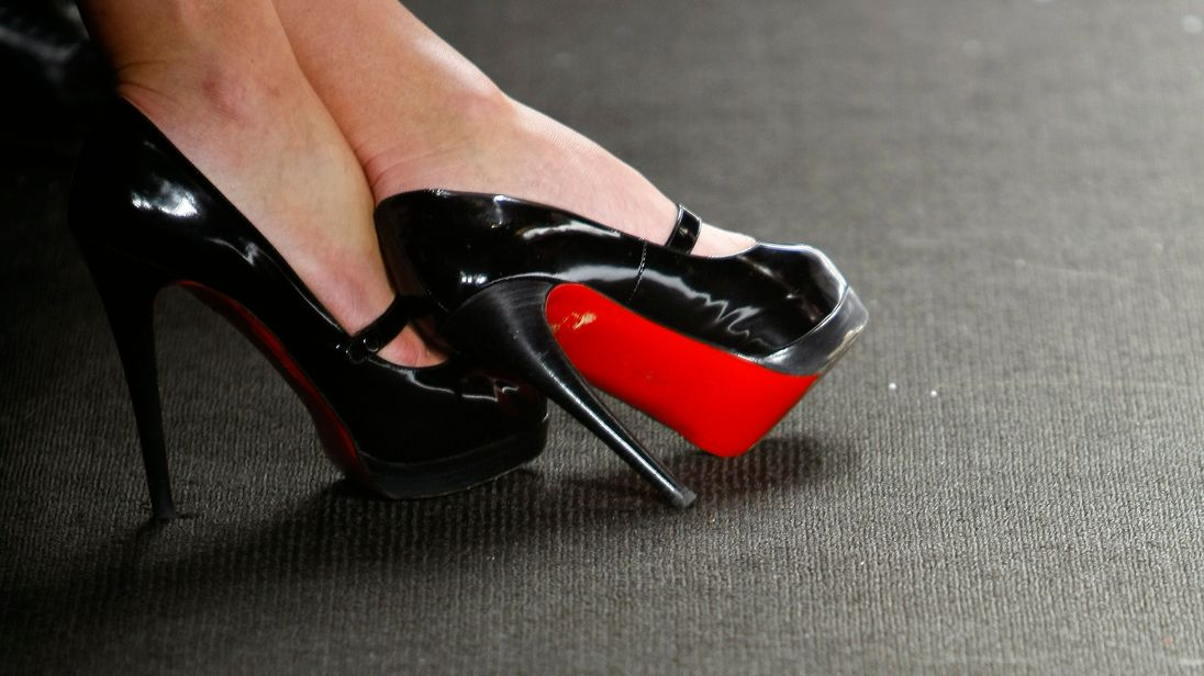 Christian Louboutin wins battle over trademarking red-soled shoes