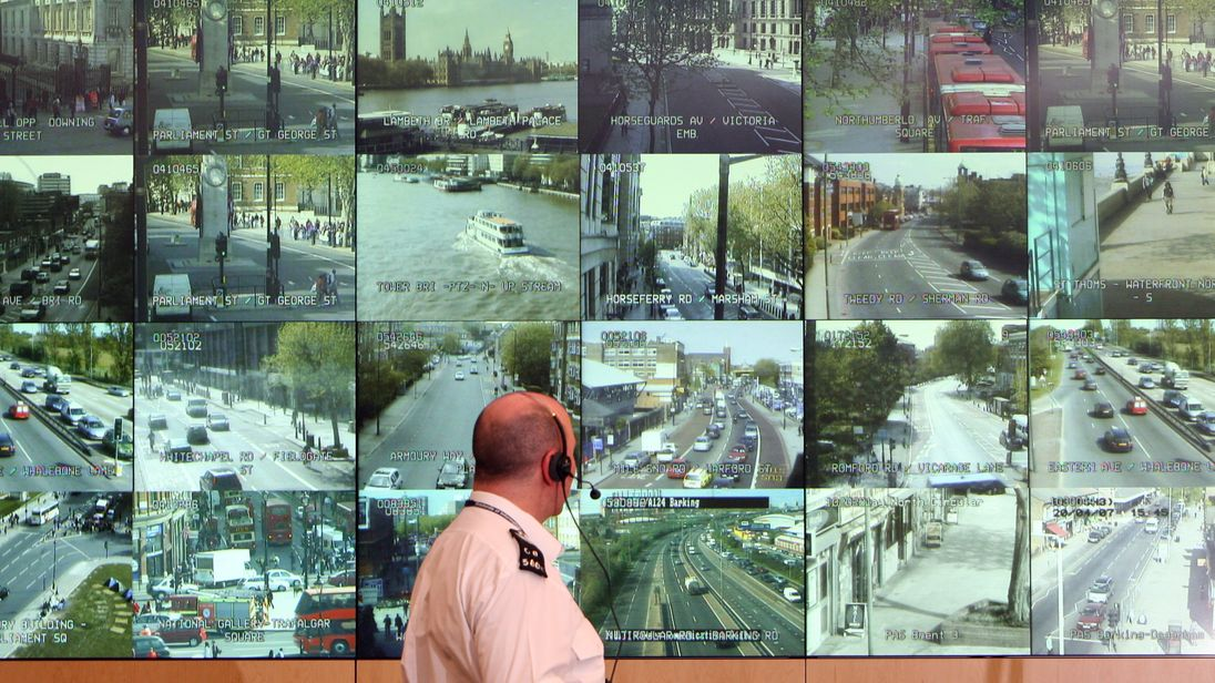 LONDON - APRIL 20: A police officer watches banks of television monitors showing a fraction of London's CCTV camera network in the Metropolitan Police's new Special Operations Room on April 20, 2007 in London, England. The new high tech operations room, believed to be the largest of its kind, is set to be the focal point for the policing of any large event or operation in London and is designed to handle public order events and major incidents, the Special Operations Room will kick off with the