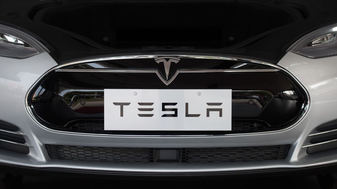 This picture taken on March 17, 2015 shows a Tesla Model S car on display at a showroom in Shanghai