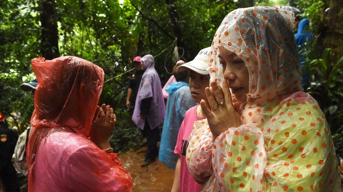 Families have kept vigil at the cave entrance