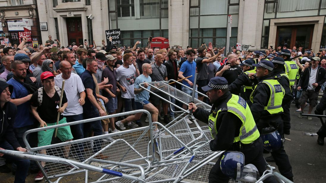 Protesters scuffle with police at the junction of Whitehall and The Mall during a gathering by supporters of far-right spokesman Tommy Robinson in central London on June 9, 2018, following the jailing of Tommy Robinson for contempt of court. (Photo by Daniel LEAL-OLIVAS / AFP) (Photo credit should read DANIEL LEAL-OLIVAS/AFP/Getty Images)