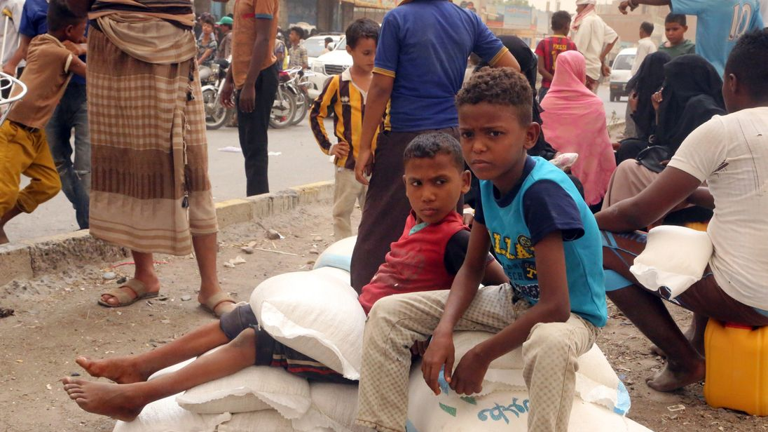 Yemeni children receive food aid in the coastal city of Hodeida