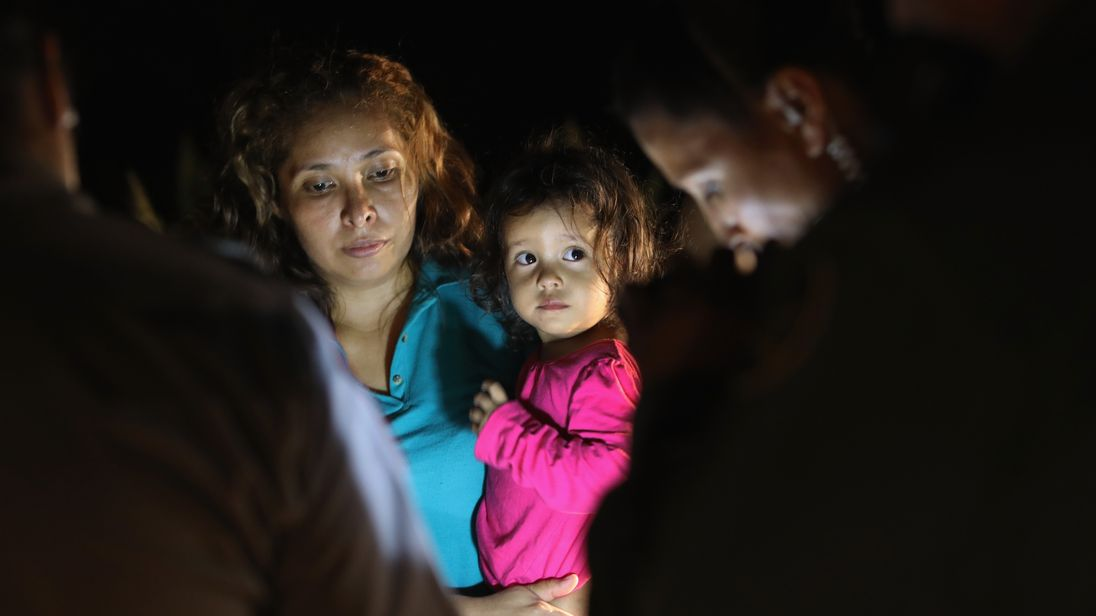 A Honduran girl, 2, and her mother, are taken into custody near the US-Mexico border