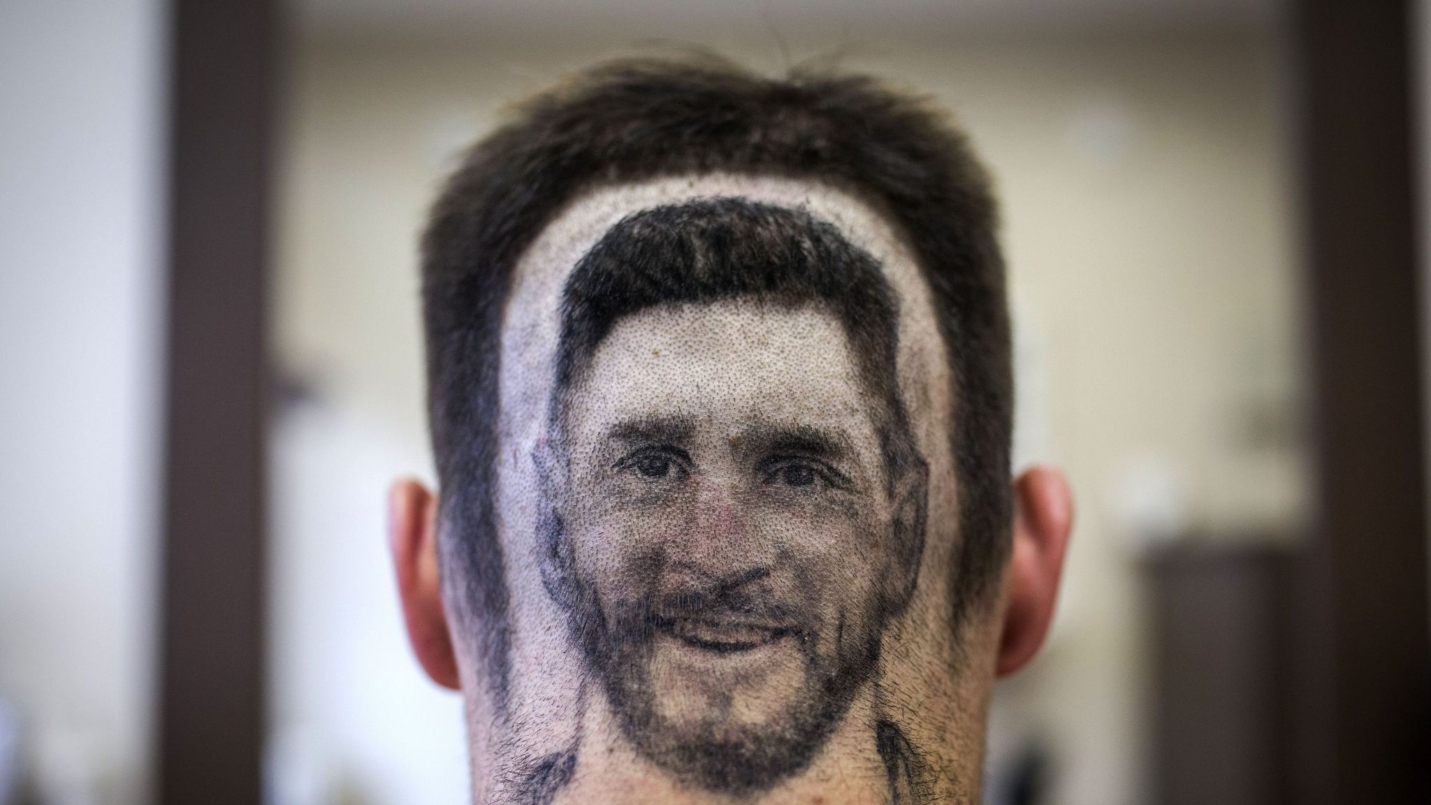 Messi Hair Barber Shaves Player S Image Into Fans Hair For World Cup Offbeat News Sky News