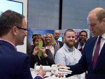 "Prince William was greeted with a ""weak"" robotic handshake in Liverpool, as he toured the International Business Festival"