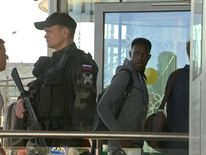England footballer Danny Welbeck eye's up the heavily armed Russian security as the team arrive in Volgograd