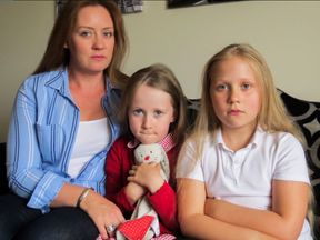Janet Alexander with daughter Rose (5) and Lois (9). Pic: Digby Brown