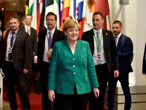 German Chancellor Angela Merkel leaves a European Union leaders summit in Brussels