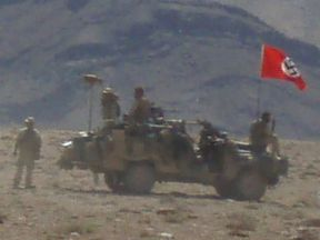 A Nazi swastika flag flies over an Australian Army vehicle in Afghanistan. Pic: ABC