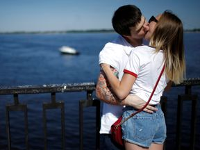 A couple kisses on the banks of the Volga river in Volgograd, Russia