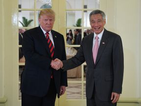 US-North Korea summit: Donald Trump shakes hands with Singapore's PM Lee Hsien Loong during his visit to Singapore on June 11, 2018, ahead of summit with Kim Jong Un