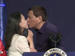 The president kissed the woman on the lips