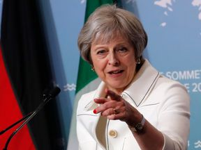 Britain's Prime Minister Theresa May addresses the final news conference of the G7 summit in the Charlevoix city of La Malbaie, Quebec, Canada, June 9, 2018