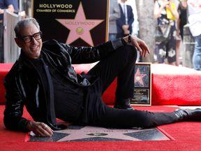 Jeff Goldblum strikes a pose as he unveils his star