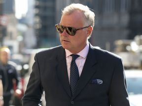Former TV presenter John Leslie arrives at Edinburgh Sheriff Court