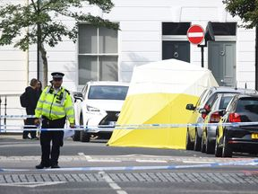 A forensic tent at the scene in Cathcart Road