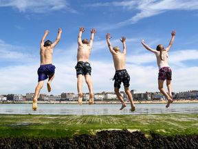 Children enjoy jumping into a sea pool in Margate