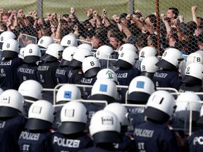 Austrian police carry out an exercise at the Spielfeld border crossing, with police cadets as 'migrants'