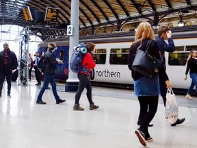 Passengers and a Northern train at Newcastle upon Tyne railway station on the day that the rail operator introduced an emergency timetable