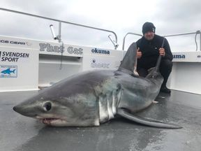Matthew Burrett with the shark