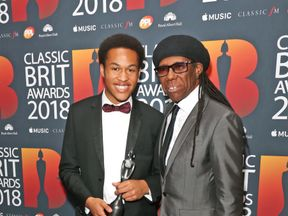 Sheku Kanneh-Mason (L) was presented with his second award by Nile Rodgers