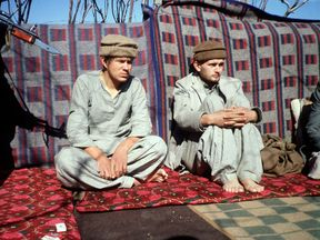 Soviet troops are held at gunpoint after being captured by Afghan fighters in 1981. File pic