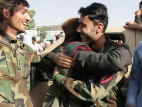 Dozens of Taliban fighters in Afghanistan's northern province of Kunduz celebrated the Islamic Eid al-Fitr holiday on Saturday, greeting Afghan security forces and local residents.