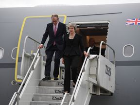 Theresa May and her husband Philip arrive in Canada for the G7 summit