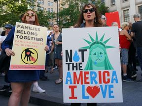 People attend a rally protesting the separation of children from their families while crossing the US border illegally on June 14, 2018 in New York