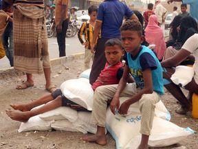 Yemeni children receive food aid in the coastal city of Hodeida