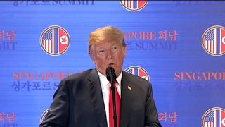 Donald Trump gives a news conference after his summit with Kim Jong Un