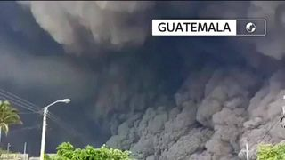 People flee as volcanic ash cloud towers above them in Guatemala