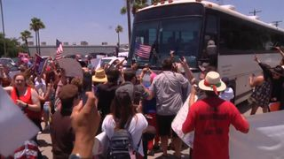 Protesters block bus