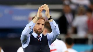 Soccer Football - World Cup - Group G - England vs Belgium - Kaliningrad Stadium, Kaliningrad, Russia - June 28, 2018 England manager Gareth Southgate applauds their fans after the match REUTERS/Marko Djurica