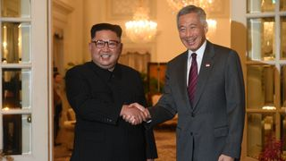 North Korea's leader Kim Jong Un is welcomed by Singapore's Prime Minister Lee Hsien Loong