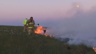 Up to 100 firefighters are tackling a blaze on Winter Hill close to the TV and radio transmitter mast near Bolton.