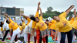 Women practise yoga in the Indian city of Bangalore