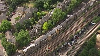 Aerial view of Loughborough Junction train station, in south London, after three people were found dead on the tracks