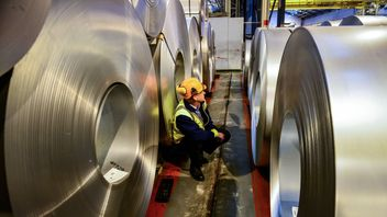 File photo dated 15/02/17 of a worker inspecting rolls of steel. Massive US tariffs on EU steel imports came into force on Friday as Britain made it clear a trans-Atlantic trade war would be bad for both sides.