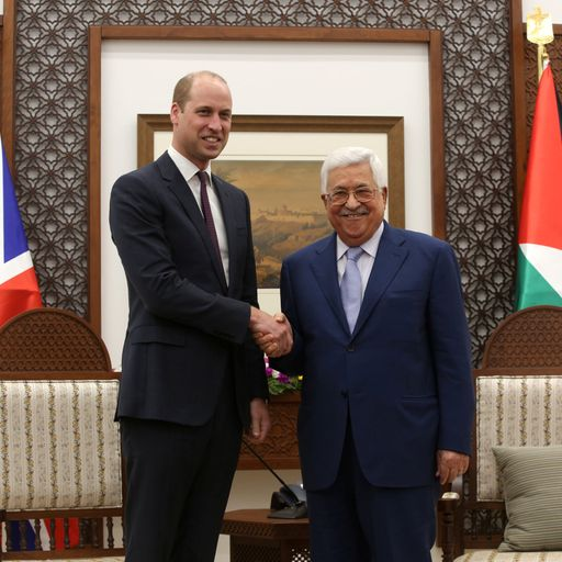 Prince William and Palestinian President Mahmoud Abbas shake hands in West Bank
