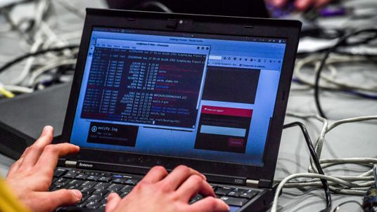 A person works at a computer during the 10th International Cybersecurity Forum in Lille on January 23, 2018. / AFP PHOTO / Philippe Huguen (Photo credit should read PHILIPPE HUGUEN/AFP/Getty Images)