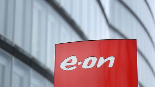 The logo of German energy giant EON is seen in front of its headquarters on March 15, 2017 in the western German town of Essen (Nordrhein-Westfalen), ahead of its annual results press conference. EON said that it booked a record loss of 8.45 billion euros ($9.0 billion) in 2016 after massively overvaluing its fossil fuels division which was spun off late last year. The previous year, EON had already run up a bottom-line loss of almost seven billion euros. / AFP PHOTO / dpa / Ina Fassbender / Ger