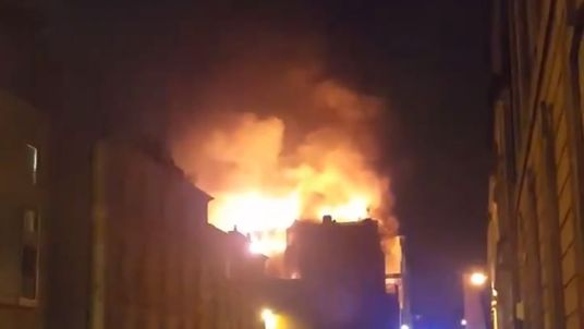 Huge flames can be seen coming from the Mackintosh building. Pic: Findlay Mair
