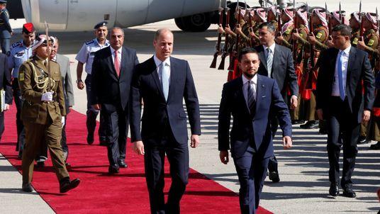 Prince William and Jordan's Crown Prince Hussein bin Abdullah II review the honour guard in Amman