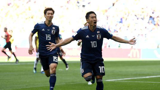 Japan's Shinji Kagawa celebrates after scoring a penalty