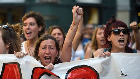 Demonstrators protest outside the court in Pamplona