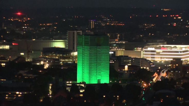 Green lights are illuminating Grenfell Tower