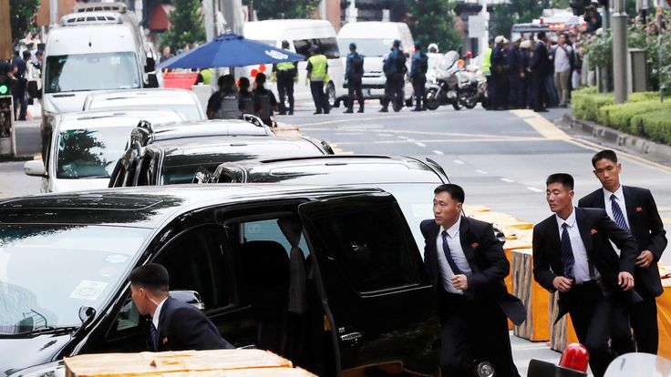 North Korean security personnel run next to a motorcade believed to be carrying North Korea's leader Kim Jong Un in Singapore June 10, 2018, ahead of the summit between the North Korean leader and U.S. President Donald Trump. REUTERS/Tyrone Siu